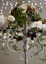 French white Spanish candelabra brought to life with berries and floral.