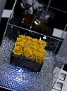 The yellow roses in this 14cm cube vase simply glowed in their setting of shining gel balls and an acrylic cube.