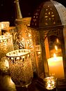 Collection of golden tea light candles and lanterns