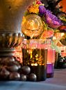 Beautiful tea lights surrounding urn of floral by Centrepiece