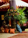 Garden Bronze fountain filled vibrant Moroccan fruit and floral by Centrepiece. Tents and fringing supplied by Raj Tents.