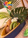 Tropical theme with fruit boat, fan palm and coconuts