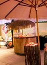 The marquee themed with tropical bar, florals and props.